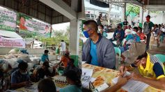 Quezon coco farmers receive cash and food assistance from PCA